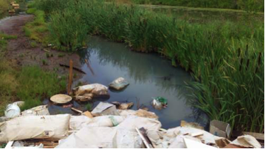 Pollution of Volosyanikha channel in a suburb of Dzerzhinsk