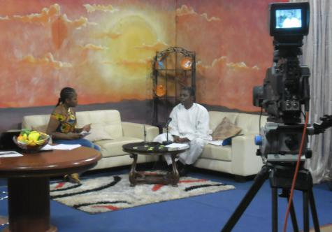 "Gilbert Kuepouo, Director of CREPD, being interviewed on ""Bonjour"" television program"