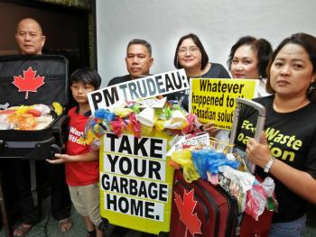 TAKE THEM OUT:  Environmental justice advocates appeal anew to visiting Prime Minister Justin Trudeau to resolve the long-drawn-out dumping controversy by returning the Canadian garbage to its origin, and rectifying the environmental injustice inflicted against the Filipino nation and people.