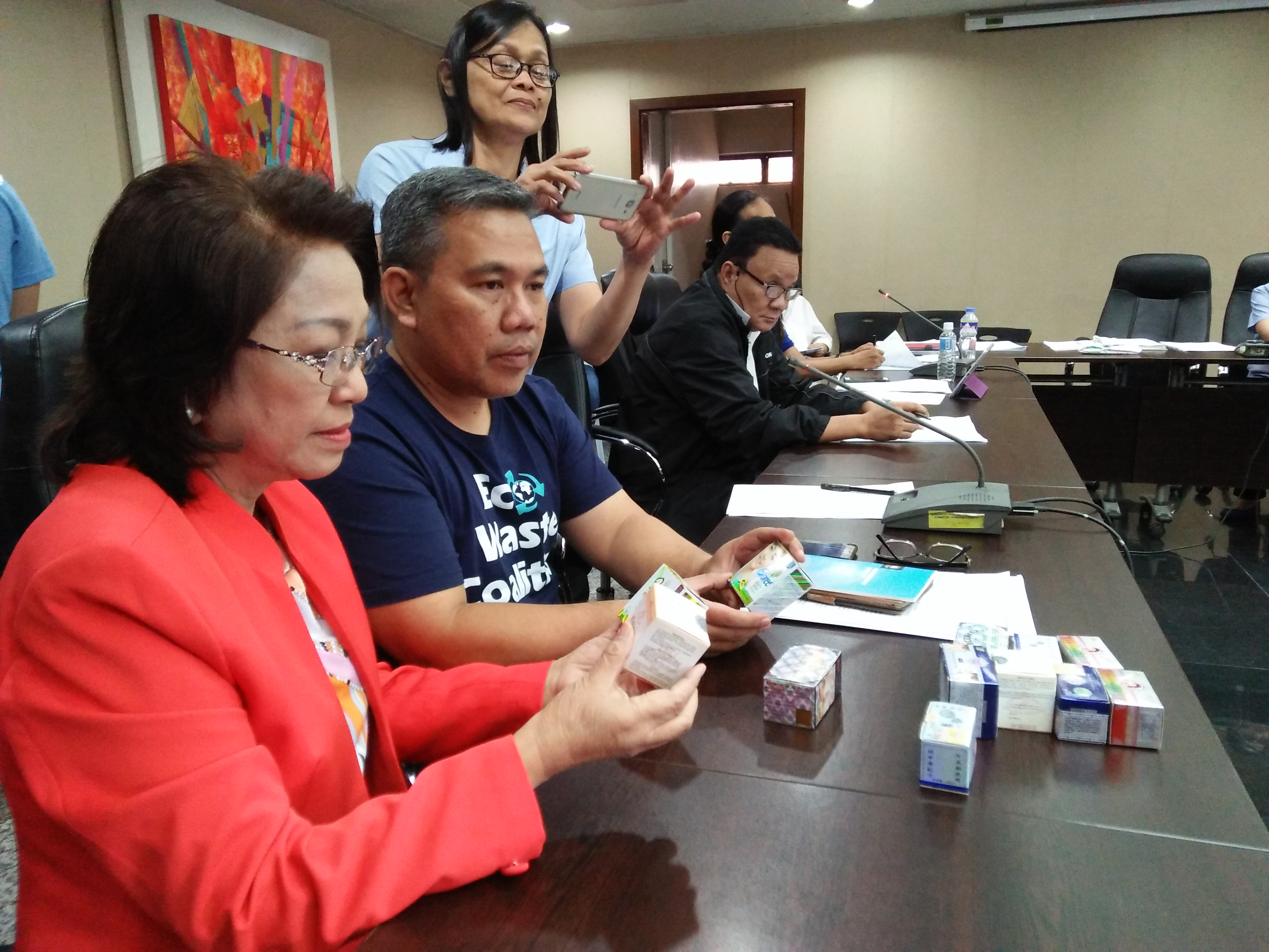 Quezon City District 1 Councilor Elizabeth Delarmente inspects contraband cosmetics contaminated with mercury that were obtained by the EcoWaste Coalition during their product test buys in the city.