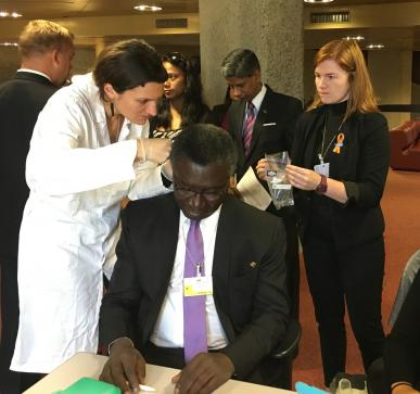 Prof. Kwabena Frimpong-Boateng, Minister for Environment, Science, Technology and Innovation (Ghana) getting his hair cut to test for mercury levels